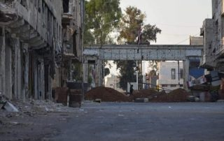 an earthen berm erected by the government forces in a street in one of the neighborhoods of the city of Daraa (al-Balad), southern Syria